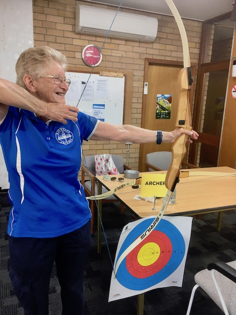Lyn Vidler demonstrating archery