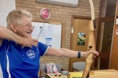 Lyn Vidler demonstrating archery